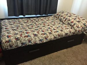 Almost new Twin bed with trundle for a second bed