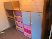 Kids bed with desk and storage.