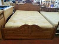 Pine kingssize bed frame with mattress and four drawers