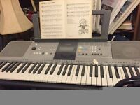 Yamaha electronic keyboard, reason for sale no longer required, boxed with stand and instructions.
