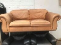 Real Tan Leather Sofa With Studs around armrest