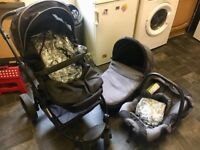 Children pram iSafe system 3 in 1. Two rain covers and footmuff included.