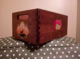 Handpainted wooden crate and matching rocks.
