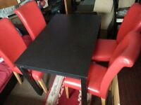 BLACK TABLE +RED LEATHER CHAIRS