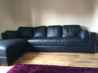 Large black leather corner sofa with chaise
