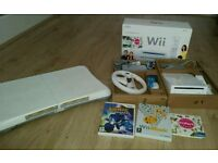 Nintendo wii console with wii fit board 3 games wii wheel