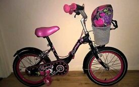 Girls pink & black bike with helmet