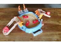 Monster Jam monster truck spinning arena foldaway playset with accessories.
