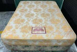 Excellent firm queen mattress with queen base. Delivery available
