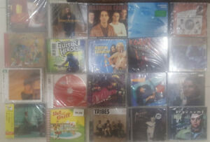 100's new CD's for Sale $1 each garage sale Sat 22 & Sun 23 Sep