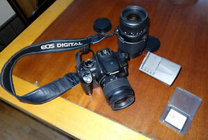 Canon Digital Rebel XT camera with two lenses.