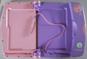 Système LeapPad rose avec 11 livres/cartouches et son cartable