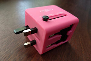 Pink travel adapter for most countries
