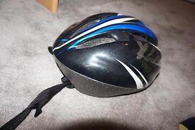 Black and Blue Medium sized helmet with adjustable strap