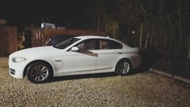 White BMW 5 Series