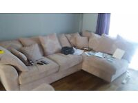 Cream/beige material corner sofa