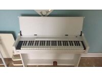 Pure white electric piano. Great condition.