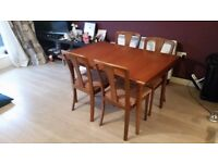 Vintage hardwood extendable dining table with four chairs