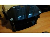 Black Glass tv unit ,Excellent condition ,can deliver for free