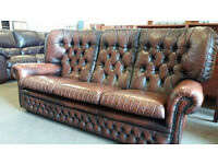 Dark brown leather chesterfield lounge sofa