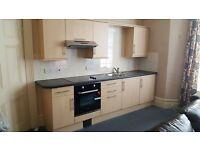 kitchenette, cooker, fridge and sink