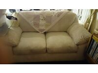 Free to collect 2 seater cream sofa