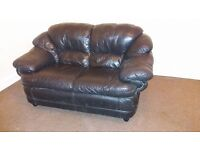 Black two-seater leather sofa, £50