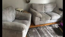 Grey two seater sofa and arm chair