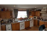 Fitted kitchen with white goods