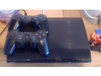 PLAYSTATION 3 CONSOLE, 20 GAMES AND 2 CONTROLLERS
