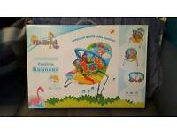 Dinosaur themed musical bouncer and activity playmat