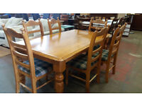 Large pine dining table with 6 chairs
