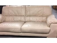 Leather cream sofa and one arm chair £140.00