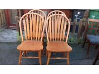 4 dining chairs,solid oak,Windsor style,carved,good physical condition,no table