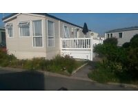 Luxury caravan to hire. Trecco bay. Lovely two bedroom, sleeps 6 with large decking area and gardens