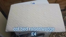 cot bed raiser/wedge , helps with reflux etc