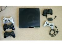 Playstation 3 / PS3 + controllers + 18 games