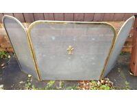 Fire screen in very good condition with brass fleur de Lys emblem