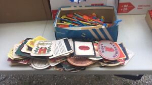 Shoebox of various coasters and stir sticks(sold pending pickup)