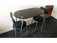 Set glass table and two chairs, very good condition