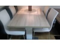 harlequin dining table and 4 or 6 white leather chairs