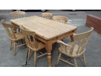 A farm house pine table 4 chairs and two carvers