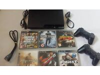 PLAYSTATION 3 SLIM / 3 CONTROLLERS / 7 GAMES / ALL WIRES INCLUDED