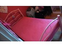 pink single bed and mattress