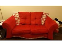 Two Red Two Seater Sofas