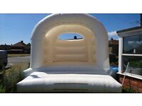 White arched bouncy castle adults and kids