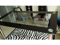 Glass and chrome dining table..