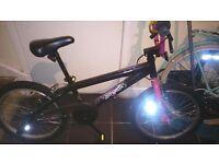 Girl stunt peg bike
