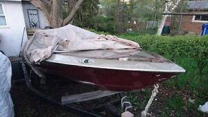16' sidewinder boat, 150hp mercury outboard, and trailer