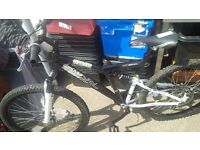 trax dual suspention bike like new!!